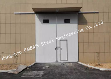 China Sectional Horizontal Sliding Industrial Garage Doors With Access Pedestrian Door For Workshop supplier