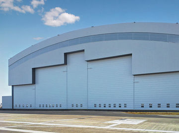 China Prefab Curve Roofing System Steel Aircraft Hangars With Electrical Slide Doors factory